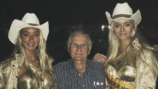 Will 'the Wrecker' Smith with some Meter Maids - he liked to have them at his Xmas functions and for photos according to Meter Maids owner Roberta Aitchison. Photo: Supplied