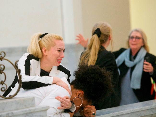 Bill Cosby accusers, from left, Caroline Heldman, Lili Bernard and Victoria Valentino, right, react outside the courtroom after Cosby was found guilty in his sexual assault retrial at the Montgomery County Courthouse in Norristown, Pa. Picture: Mark Makela