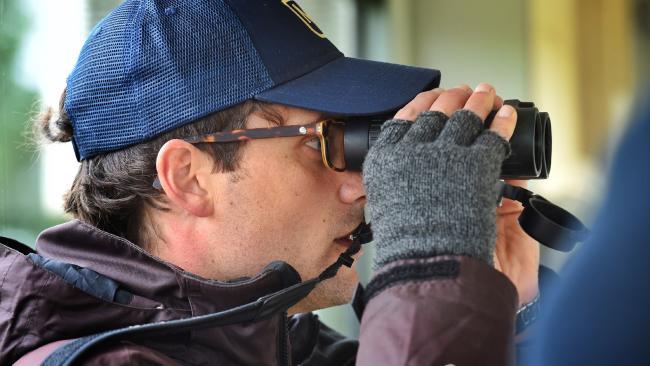 Trainer Matt Cumani checks up on his horses on the hill track at Ballarat. Picture: Tony Gough