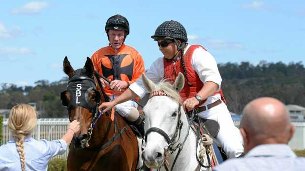 TREBLE TIME: Jockey Jim Byrne is led into the Ipswich enclosure aboard Tough One, the first of his three wins last Friday.