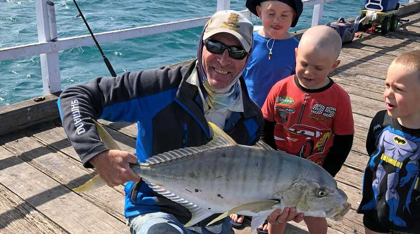 Nick Roland on the Urangan Pier with his catch.