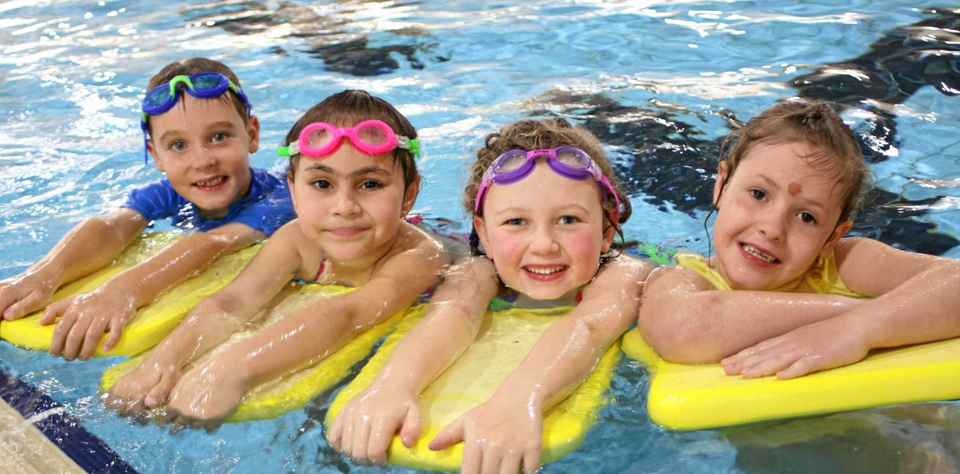 SWIMMING FUN: Matthew Owens, Jashari McIntosh, Charlotte Stevens and Luciana Favero, all six-years-splashing away at their afternoon swimming lessons at WIRAC.