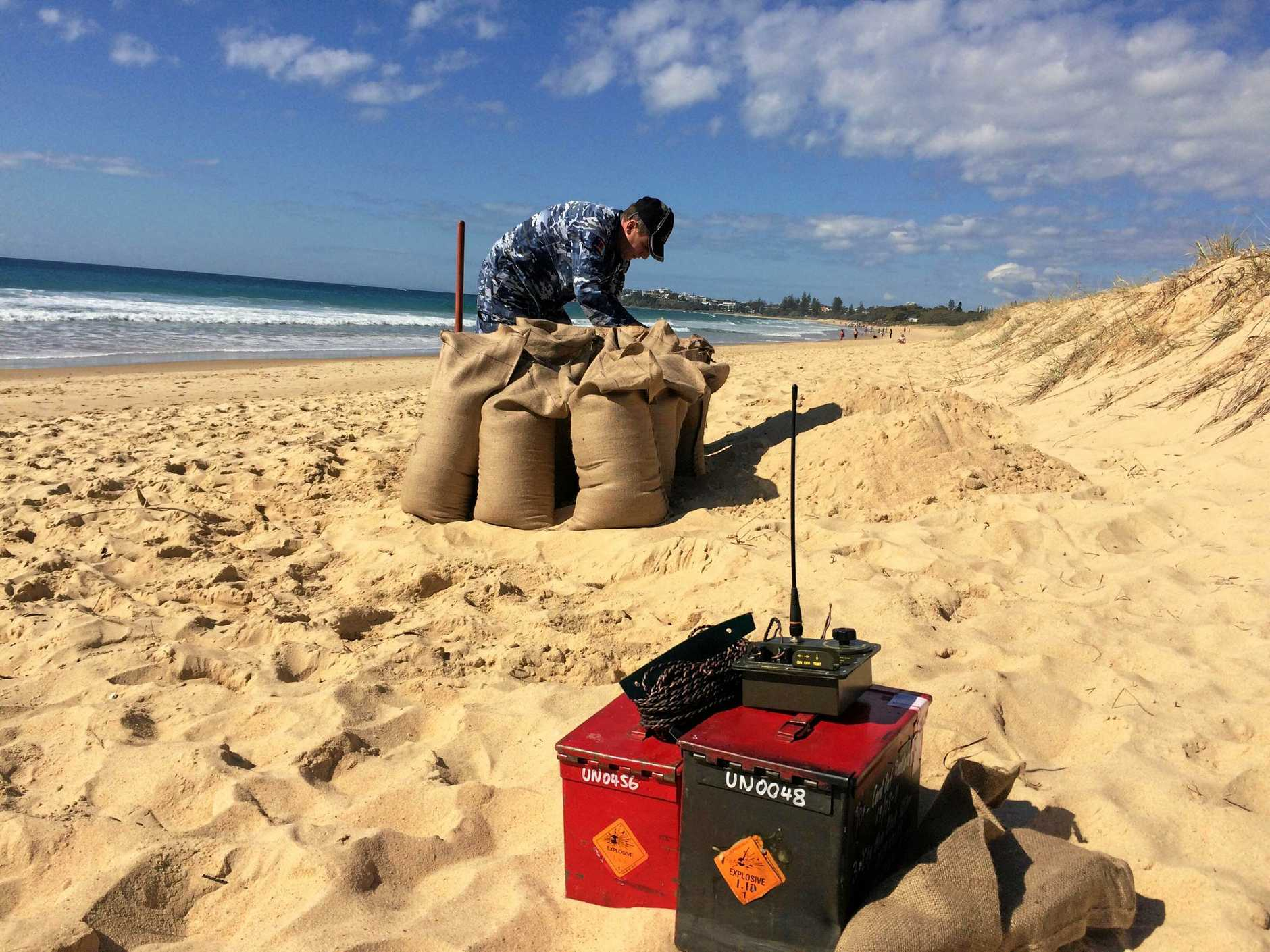Air Force warrant officer Damien Holding prepares to detonate