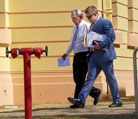 GOING TO TRIAL: Accused flasher Edward Jeremy Liddicoat, 72, leaves Maryborough Magistrates Court with his lawyer John Willett.