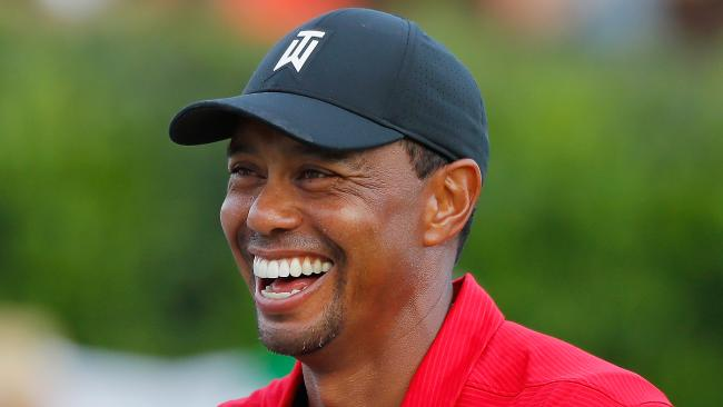 Tiger Woods is all smiles after breaking through for a win at the Tour Championship.
