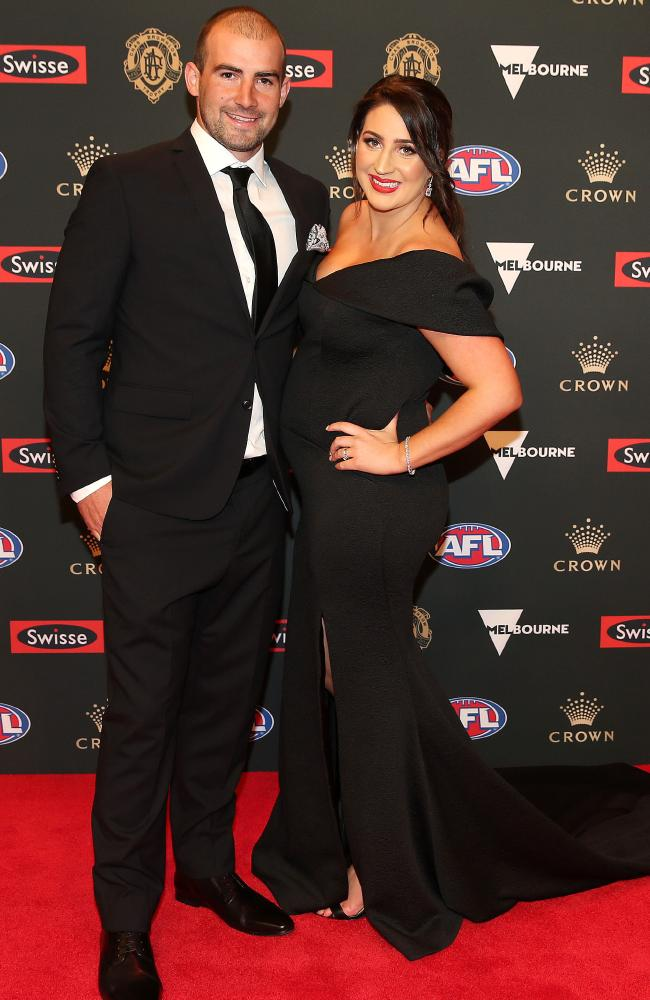 North Melbourne player Ben Cunnington and wife Belinda. Pic: Michael Klein