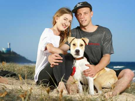 Life for a beach dog is pretty good as Max joins new owner Djembe Jones, 20, and partner Jacob Connelly, 20, for an afternoon on the Sunshine Coast's Buddina beach. Photo Lachie Millard