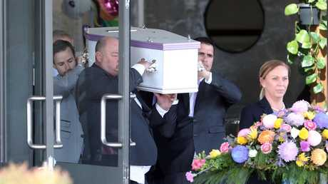 Olivia's beloved stepfather Tim Stark carries the casket of the 8 year old. Photo by Richard Gosling
