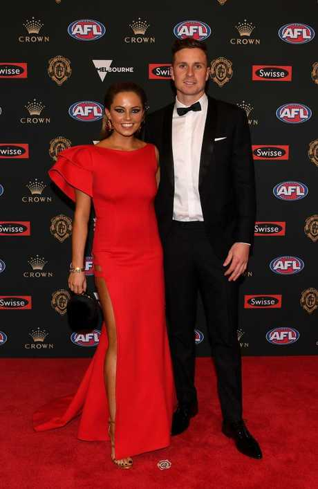 Mitch Duncan of Geelong and partner Demi Miles.