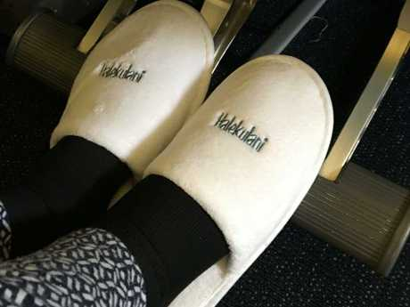 Pinch your hotel slippers to wear on the plane.