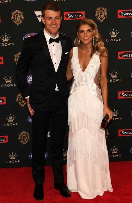 Jackson Macrae of Western Bulldogs and partner Louisa MacLeod.