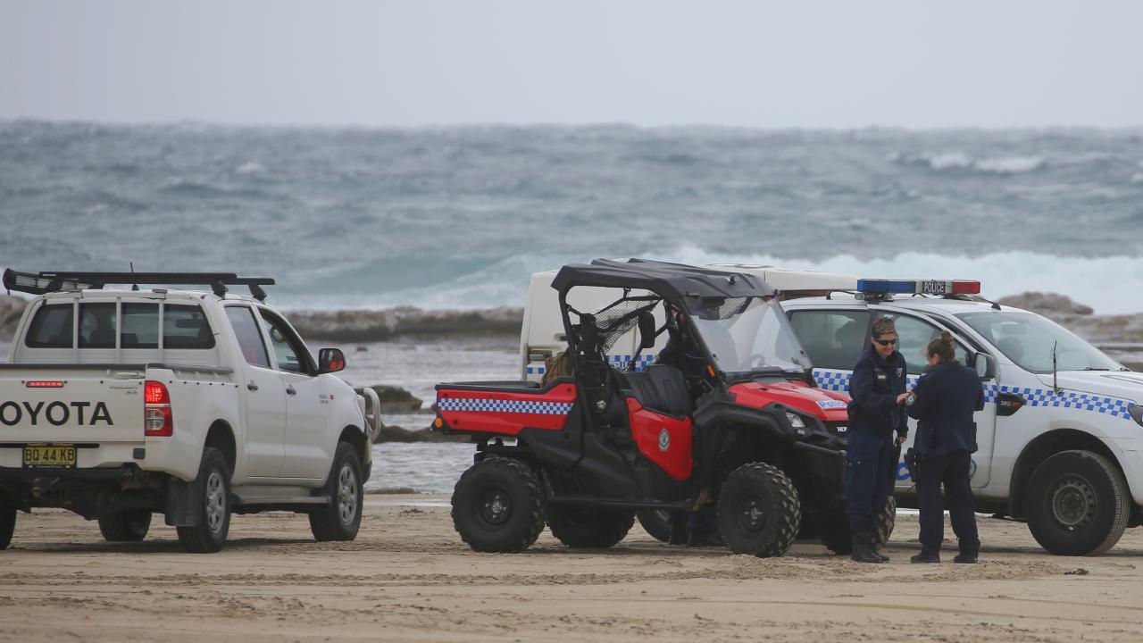 Police at the scene on Wanda Beach Boat. Picture John Grainger