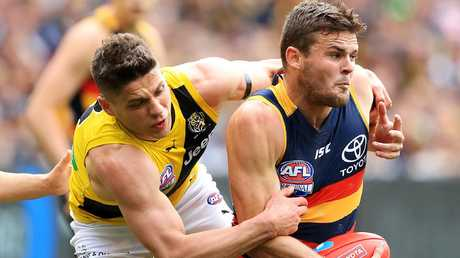 Adelaide Crow Brad Crouch under pressure from Richmond Tiger Dion Prestia in last year's grand final. Picture: Mark Stewart