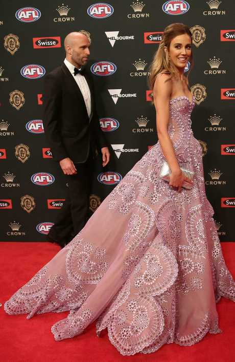 Chris Judd stands back to let wife Rebecca take the limelight.