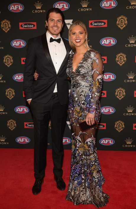 Isaac Smith of the Hawks and his partner Candice Quinlan.