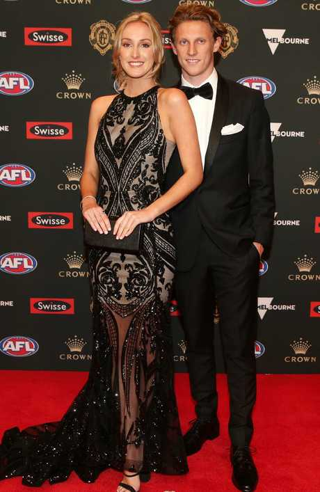 Giants player Lachie Whitfield and Brigitta Olsen. Pic: Michael Klein