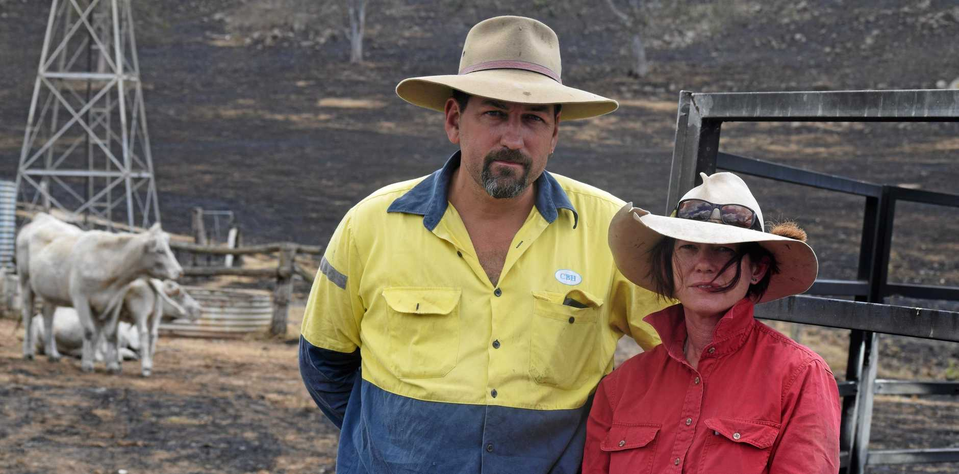 Bradley and Anne Maree Pike at their Woolooga property where they lost close to 700 acres (283ha) of grazing land to bushfire.