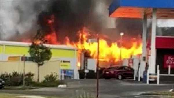 Workshop fire threatens service station
