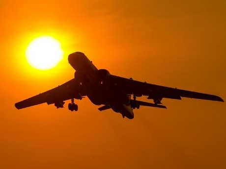 A Chinese H6K takes off into a golden dawn. Beijing has been proudly boasting of its position as a new world power. Picture: Xinhua