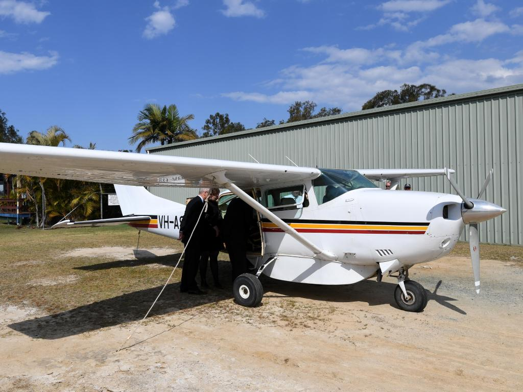 Legal teams inspect a Cessna 206 plane as part of the inquest. Picture: Dan Peled/AAP