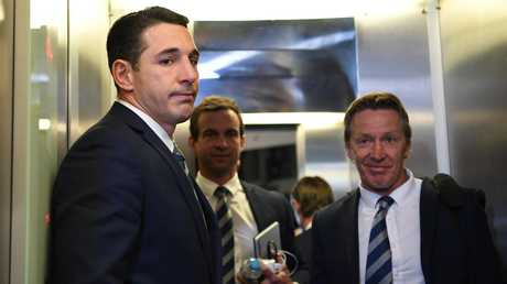 Melbourne Storm NRL player Billy Slater (left) is seen leaving League Central after his shoulder charge hearing.