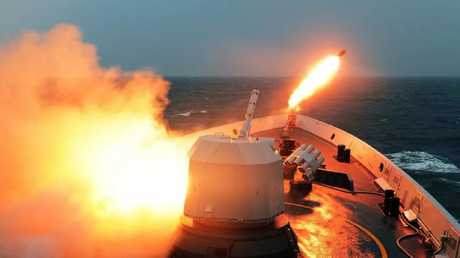 A Chinese frigate launches a rocket during a recent military exercise. Beijing is expanding an international network of naval and air bases in the Pacific and Indian Oceans. Picture: Xinhua