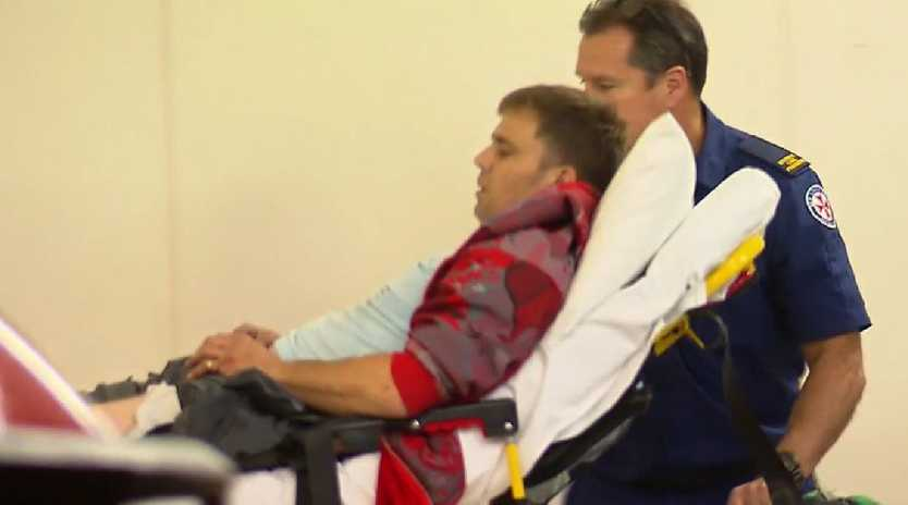 The man is transported by paramedics after being injured by the device. Picture: Nine News