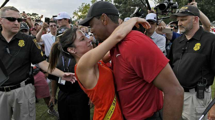 ATLANTA, GA - SEPTEMBER 23: Tiger Woods and his girlfriend Erica Herman celebrate after the final round of the TOUR Championship at East Lake Golf Club on September 23, 2018, in Atlanta, Georgia. (Photo by Stan Badz/PGA TOUR)