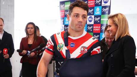 Roosters Cooper Cronk with his arm in a sling yesterday. Picture: Brett Costello