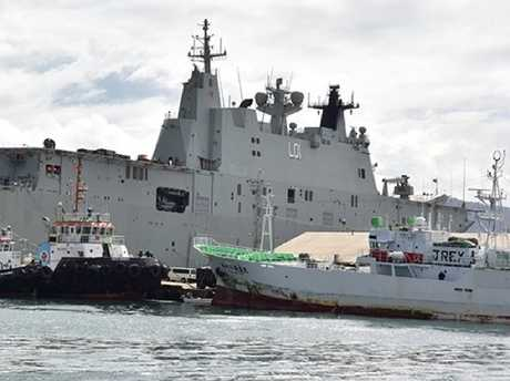 HMAS Adelaide berthed at the Port of Suva in June. Photo: DEPTFO News