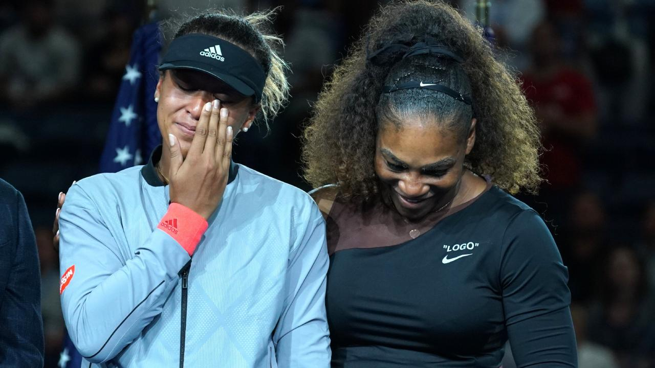A tearful Naomi Osaka is comforted by Serena Williams at the US Open. Picture: AFP