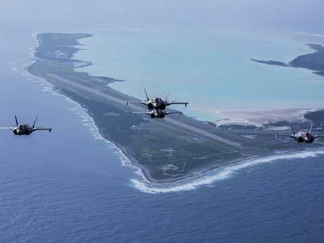 F-35B Lightning IIs with US Marine Fighter Attack Squadron 211 fly over Wake Island, one of a series of military bases retained after World War II. China wants its own 'buffer zone' of islands in the Pacific and Indian Ocean to protect its interests. Picture: US Marines