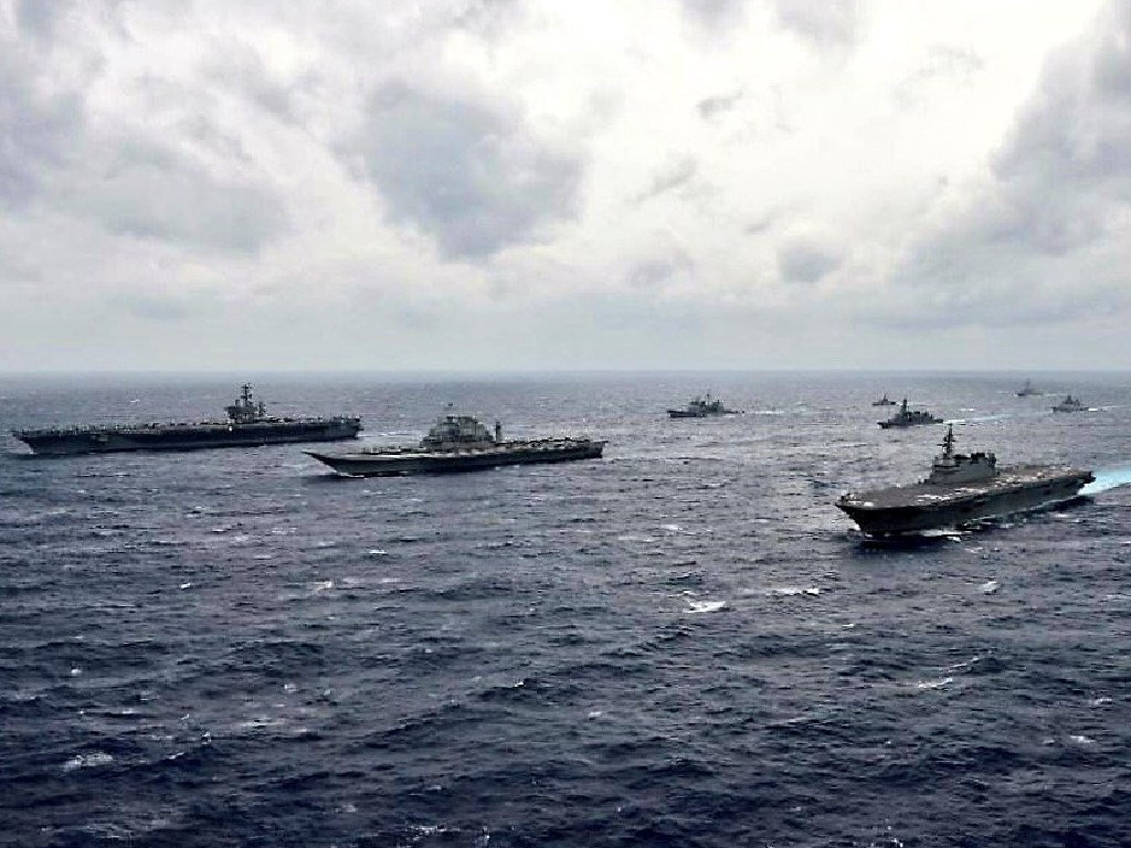 United States, Indian and Japanese warships exercise together. Concern at Beijing's expansive ambitions have drawn regonal powers together. Picture: USN