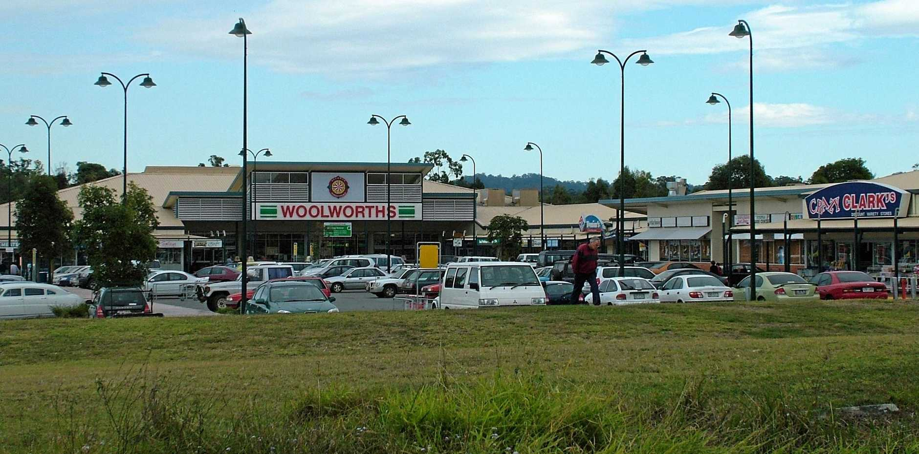 An angry customer sent Beerwah Woolworths into lockdown when he falsely threatened he'd planted a bomb in the aisle.