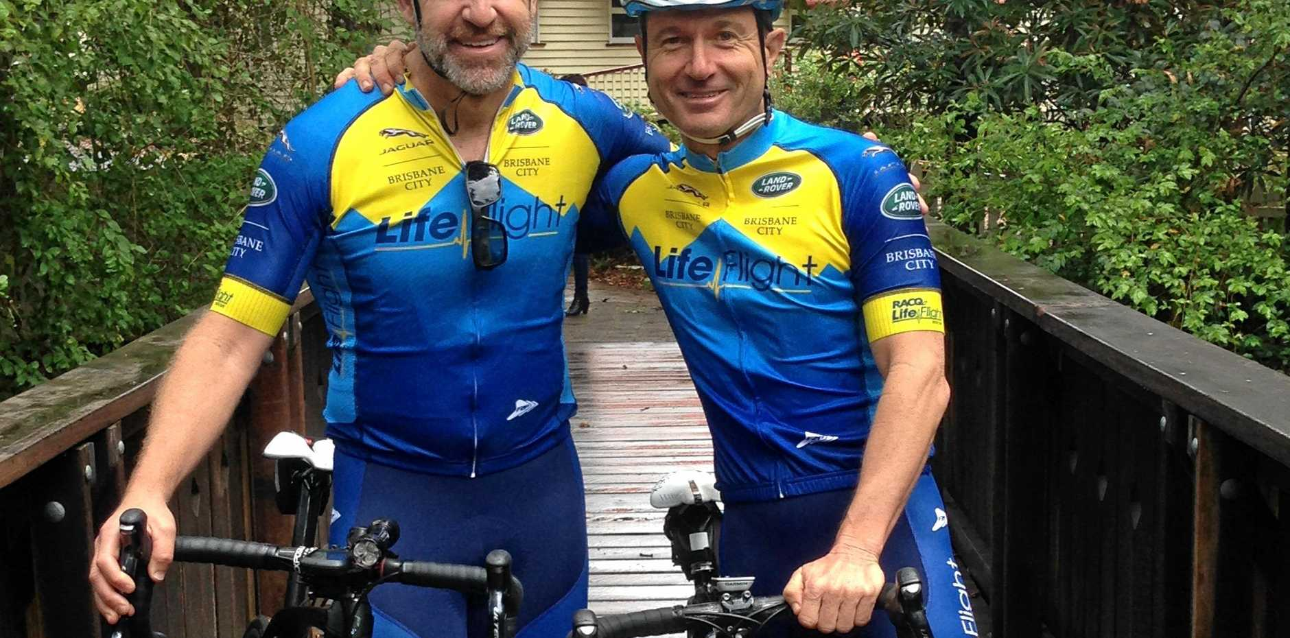 Senior RACQ LifeFlight critical care paramedic and Aircrew officer Brad Solomon  and former patient Andrew Paddison ready for the LifeFlight Razor Challenge Series.