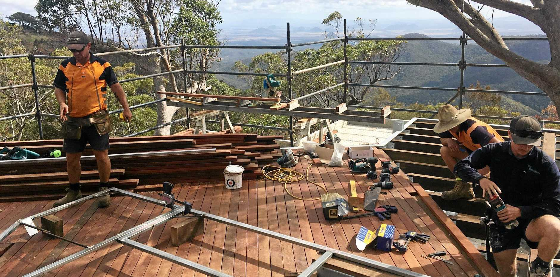 BUSY WORKERS: The second stage (Stage 1B) of Mount Archer's elevated boardwalk walk will provide the public spectacular views to the north and east, looking towards Yeppoon, after it opens in December.