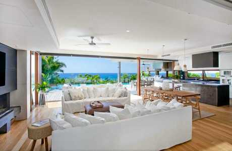 FOR SALE: Coolum Beach product and pro surfer Julian Wilson's stunning Peregian Beach mansion has hit the market.
