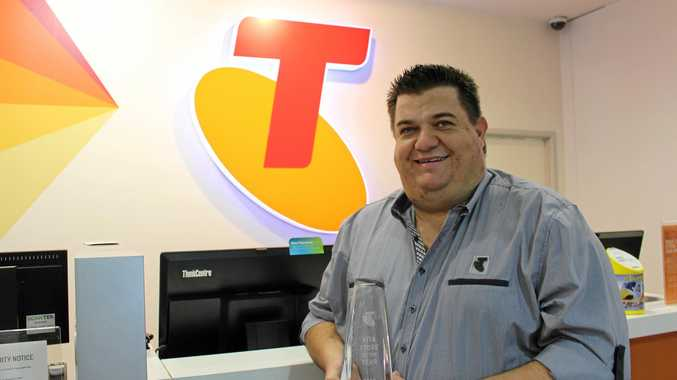 Telstra Manager Jason Koy holding the Vita Store of the Year award