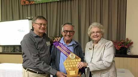 WINNER: Murwillumbah Garden Club president Wayne Tagget  with Brian Connolly  and patroness Marguerite Boyd.