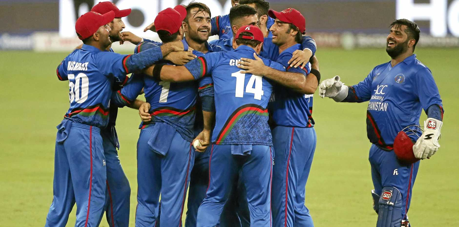 Afghanistan players celebrate the dismissal of India's Ravindra Jadeja during their Asia Cup one day international match in Dubai. Picture: Aijaz Rahi/AP