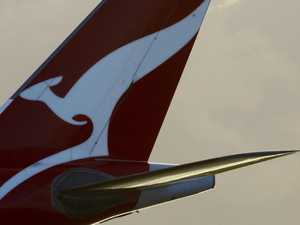 Phone sparks panic on Qantas flight