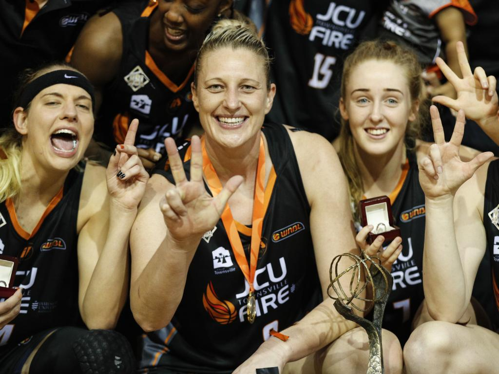 Suzy Batkovic of Townsville Fire celebrates with teammates after winning the 2017/2018 WNBL championship. (AAP Image/Dave Acree)
