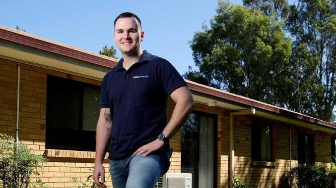 Eddie Dilleen, Property Investor & Buyers Agent, posing in front of a unit he owns on Chambers Flat Rd, Marsden, Brisbane. Picture: AAP Image/Steve Pohlner.