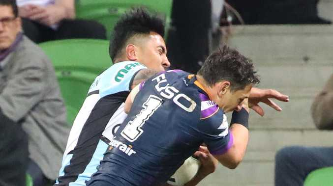Billy Slater has been cleared of a shoulder charge for this hit on Cronulla's Sosaia Feki, freeing him to play in Sunday's NRL grand final. Picture: Getty