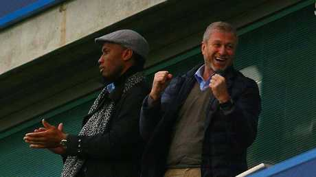 Abramovich with Blues legend Didier Drogba.