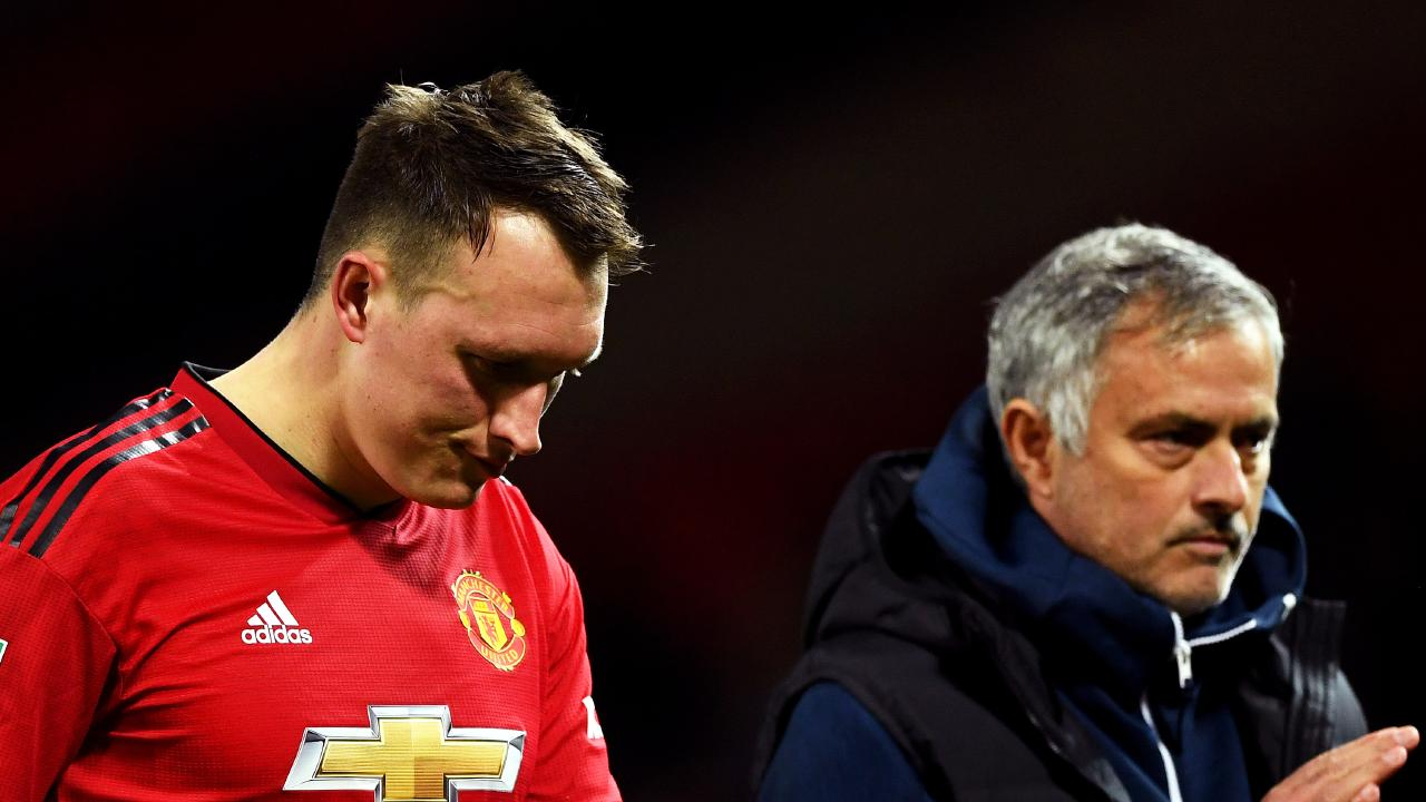 Jose Mourinho (R) and a shattered Phil Jones. Picture: Getty