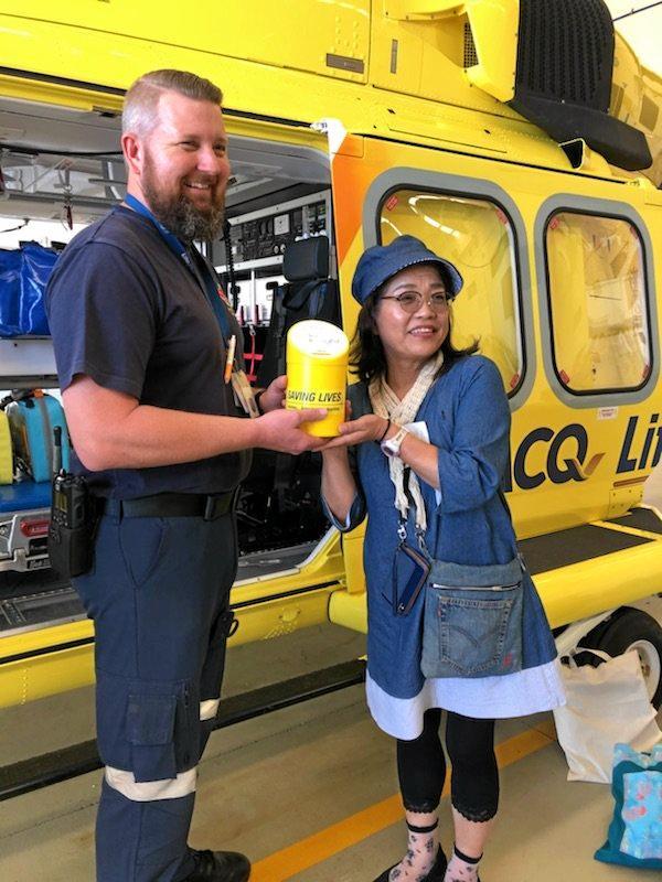 FRIENDLY DONATION: Paramedic Damien Storeywood with Japan Friendship Force member Kazue Ono.
