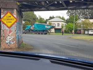 Toll truck 'origamied' by notorious Lismore railway bridge
