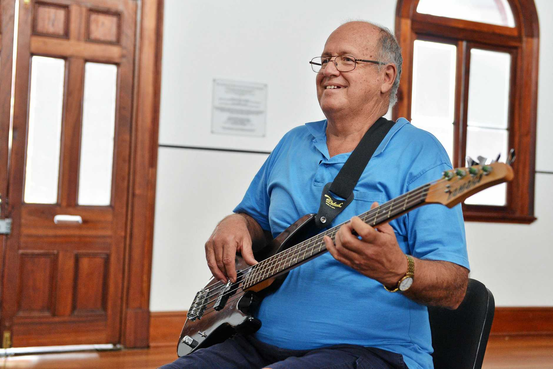 Preparing for Gympie's woodNmusic festival being held at the AICM Hall, 26 Channon Street, Gympie on May 29, 30 & 31st.  Dr. Geoff Walden strumming on a base guitar.   Photo Greg Miller / Gympie Times
