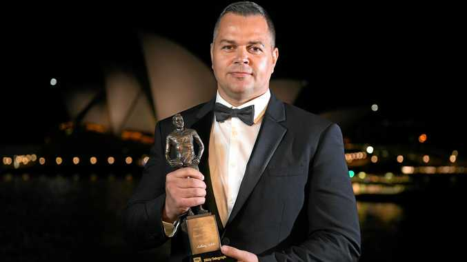 South Sydney Rabbitohs coach Anthony Seibold shows off the Dally M Coach of the Year award in Sydney. Picture: Dan Himbrechts/AAP